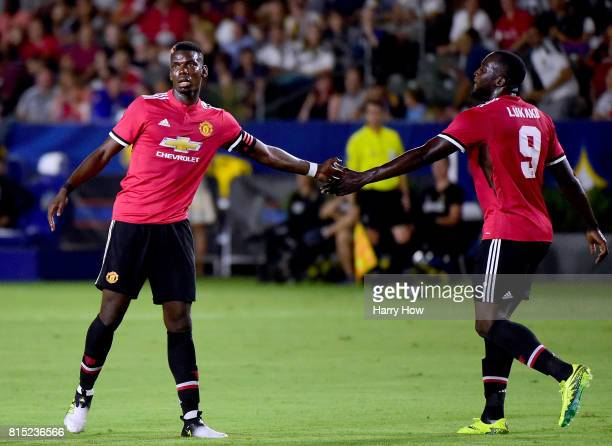 Paul Pogba and Romelo Lukaku of Manchester United celebrate a 40 lead after a goal from Henrikh Mkhitaryan during the second half at StubHub Center...