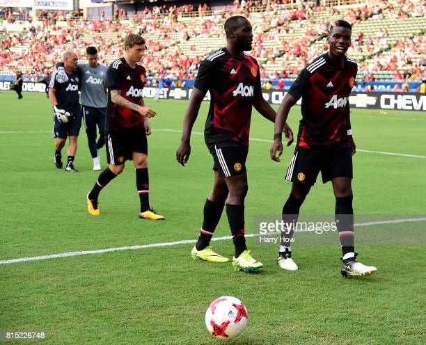 Paul Pogba and Romelo Lukaku of Manchester United leave the field after warming up before the match against the Los Angeles Galaxy at StubHub Center...