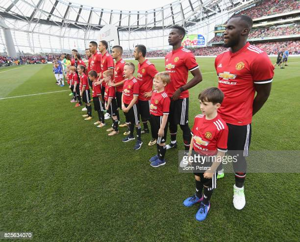Paul Pogba and Romelu Lukaku of Manchester United line up with the United team ahead of the International Champions Cup preseason friendly match...