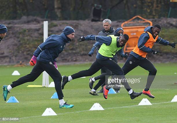 Paul Pogba and Timothy FosuMensah of Manchester United in action during a first team training session at Aon Training Complex on November 18 2016 in...