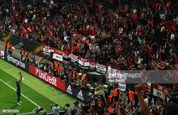 Paul Pogba holds up the trophy to the Manchester United supporters following victory in the UEFA Europa League Final between Ajax and Manchester...