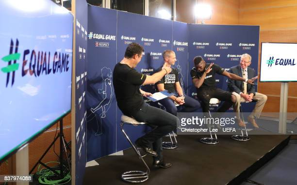 Paul Pogba in the company of UEFA President Aleksander Ceferin and UEFA Chief of Communications and Media Pedro Pinto is interviewed during a...
