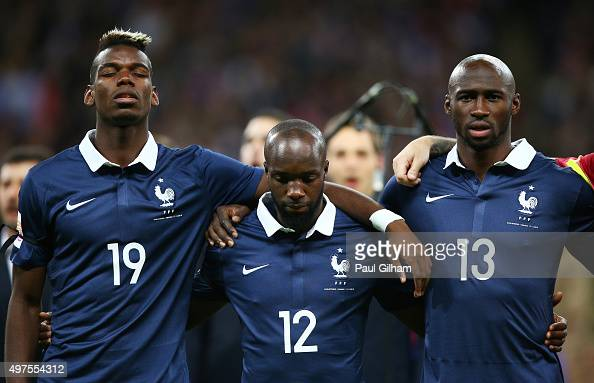 Paul Pogba Lassana Diarra and Eliaquim Mangala of France line up for the national anthem prior to the International Friendly match between England...