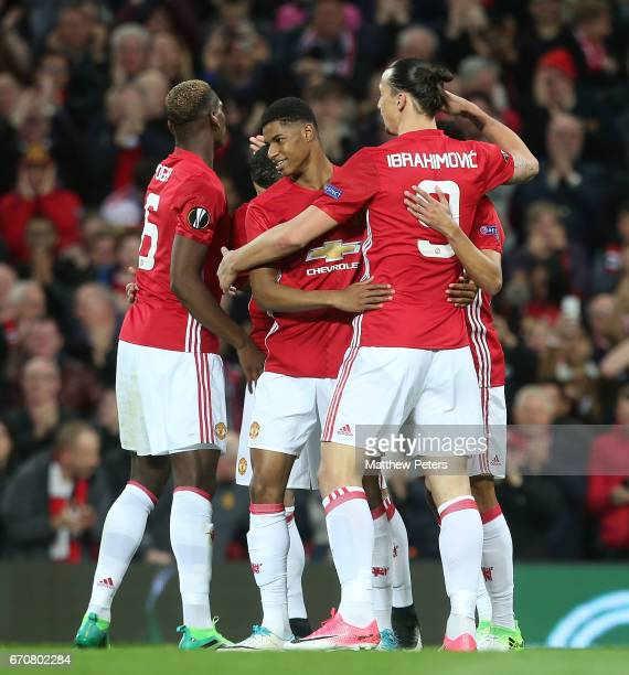 Paul Pogba Marcus Rashford and Zlatan Ibrahimovic of Manchester United celebrate Henrikh Mkhitaryan scoring their first goal during the UEFA Europa...