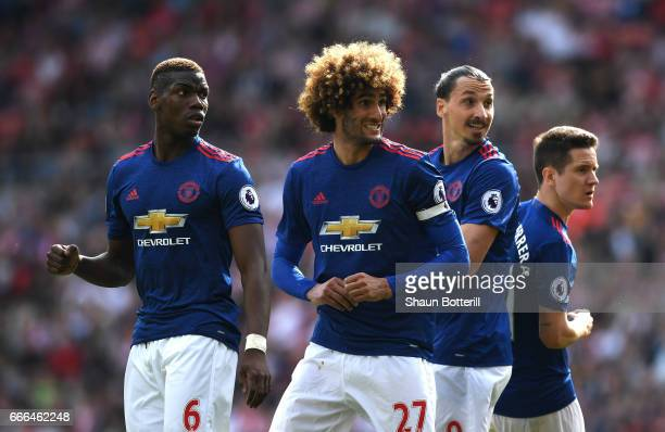 Paul Pogba Marouane Fellaini Zlatan Ibrahimovic and Ander Herrera of Manchester United look on after a free kick during the Premier League match...