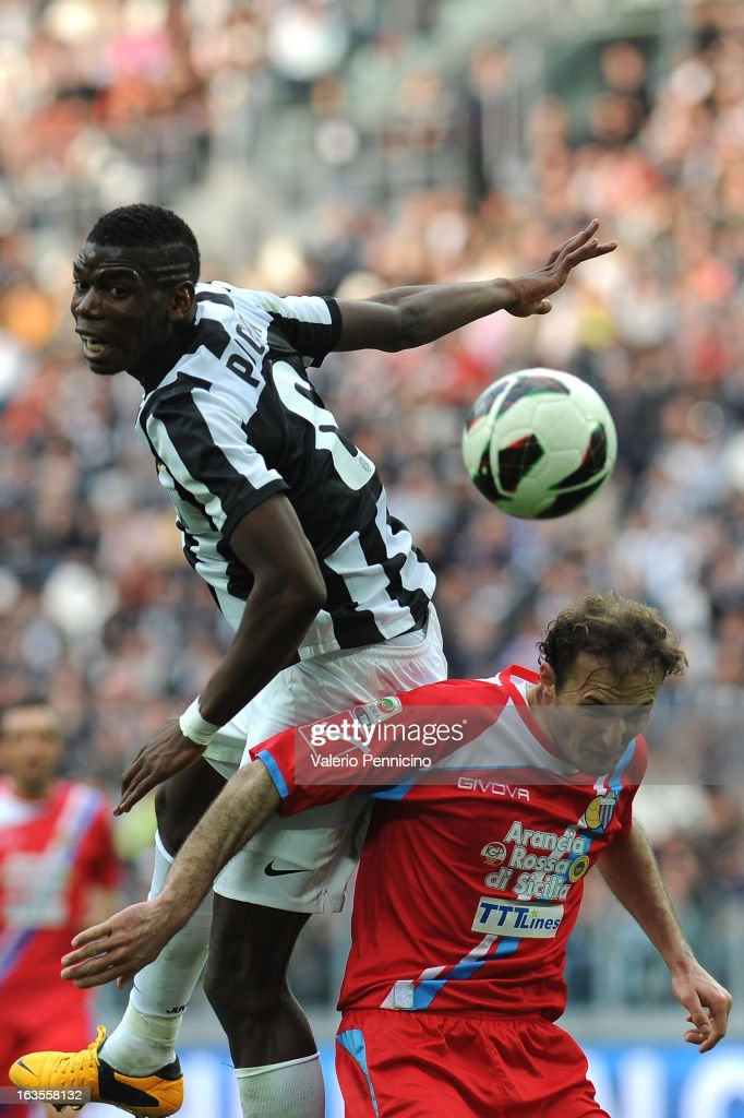 Paul Pogba (L) of FC Juventus clashes with Giovanni Marchese of Calcio Catania during the Serie A match between FC Juventus and Calcio Catania at Juventus Arena on March 10, 2013 in Turin, Italy.
