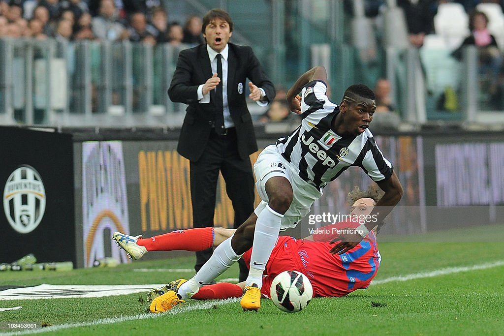 Paul Pogba of FC Juventus runs of Giovanni Marchese of Calcio Catania during the Serie A match between FC Juventus and Calcio Catania at Juventus Arena on March 10, 2013 in Turin, Italy.