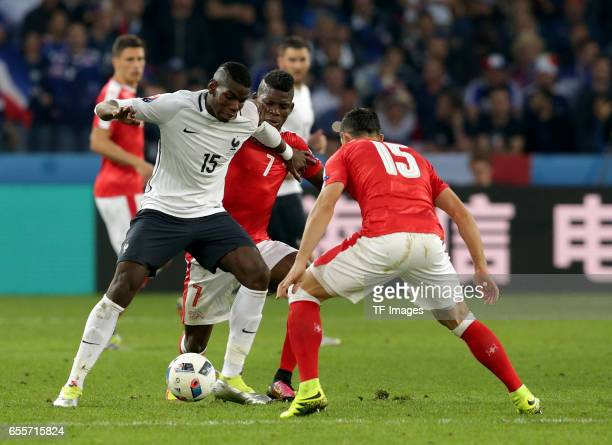 Paul Pogba of France and Breel Embolo of Switzerland and Blerim Dzemaili of Switzerland battle for the ball during the UEFA Euro 2016 Group A match...