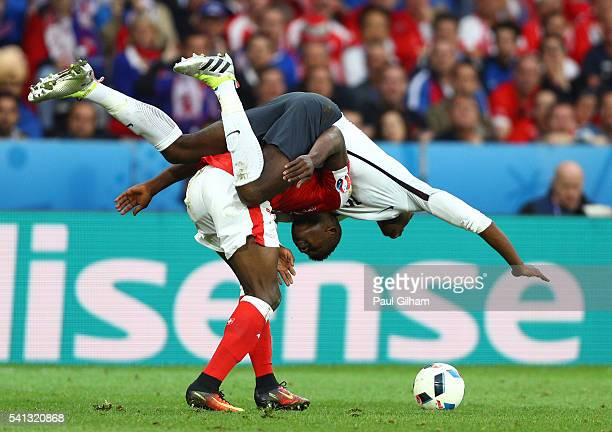 Paul Pogba of France and Breel Embolo of Switzerland compete for the ball during the UEFA EURO 2016 Group A match between Switzerland and France at...