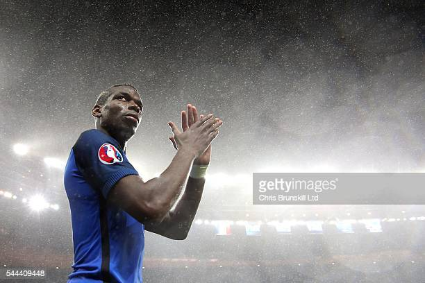 Paul Pogba of France applauds the supporters following the UEFA Euro 2016 Quarter Final match between France and Iceland at Stade de France on July...