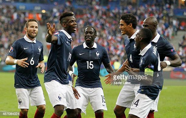 Paul Pogba of France celebrates his goal with team matte during the International Friendly Soccer match between France and Portugal at Stade de...