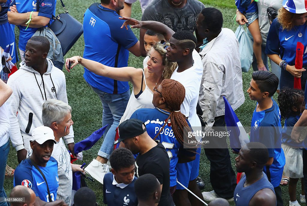 <a gi-track='captionPersonalityLinkClicked' href=/galleries/search?phrase=Paul+Pogba&family=editorial&specificpeople=5805302 ng-click='$event.stopPropagation()'>Paul Pogba</a> of France celebrates his team's 2-1 win with his family after the UEFA EURO 2016 round of 16 match between France and Republic of Ireland at Stade des Lumieres on June 26, 2016 in Lyon, France.