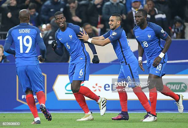 Paul Pogba of France celebrates scoring a goal with Dimitri Payet Moussa Sissoko during the FIFA 2018 World Cup Qualifier between France and Sweden...