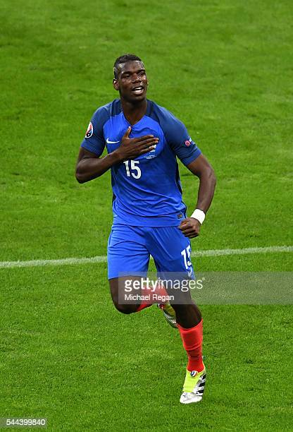 Paul Pogba of France celebrates scoring his team's second goal during the UEFA EURO 2016 quarter final match between France and Iceland at Stade de...
