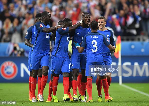 Paul Pogba of France celebrates scoring his team's second goal with his team mates during the UEFA EURO 2016 quarter final match between France and...
