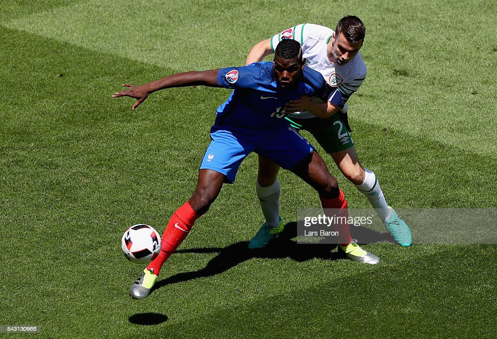 <a gi-track='captionPersonalityLinkClicked' href=/galleries/search?phrase=Paul+Pogba&family=editorial&specificpeople=5805302 ng-click='$event.stopPropagation()'>Paul Pogba</a> of France controls the ball under pressure of <a gi-track='captionPersonalityLinkClicked' href=/galleries/search?phrase=Seamus+Coleman&family=editorial&specificpeople=6005260 ng-click='$event.stopPropagation()'>Seamus Coleman</a> of Republic of Ireland during the UEFA EURO 2016 round of 16 match between France and Republic of Ireland at Stade des Lumieres on June 26, 2016 in Lyon, France.