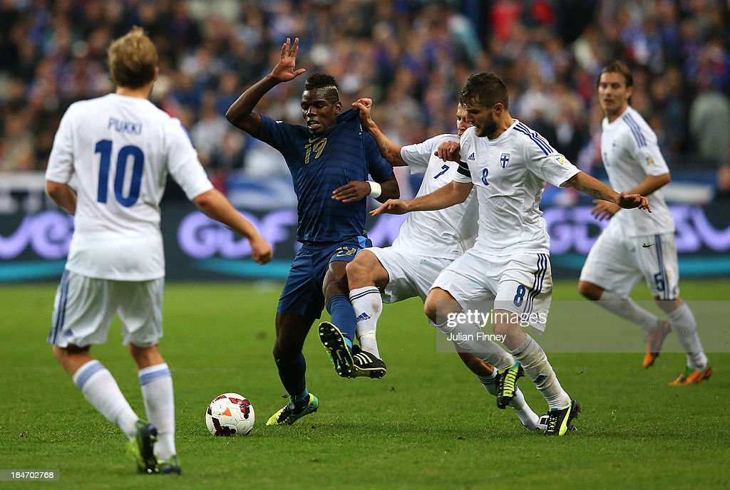 <a gi-track='captionPersonalityLinkClicked' href=/galleries/search?phrase=Paul+Pogba&family=editorial&specificpeople=5805302 ng-click='$event.stopPropagation()'>Paul Pogba</a> of France has his shirt pulled by Roman Eremenko of Finland during the FIFA 2014 World Cup Qualifying Group I match between France and Finland at the Stade de France on October 15, 2013 in Paris, France.