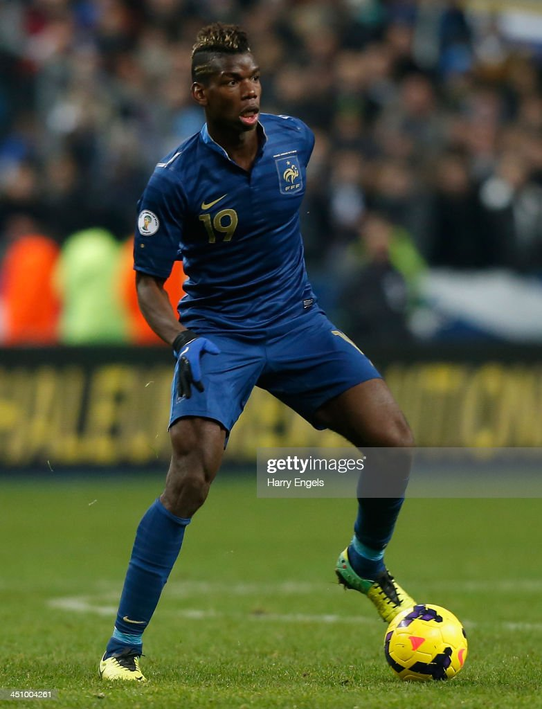 Paul Pogba of France in action during the FIFA 2014 World Cup Qualifier 2nd Leg Playoff between France and Ukraine at the Stade de France on November 19, 2013 in Paris, France.