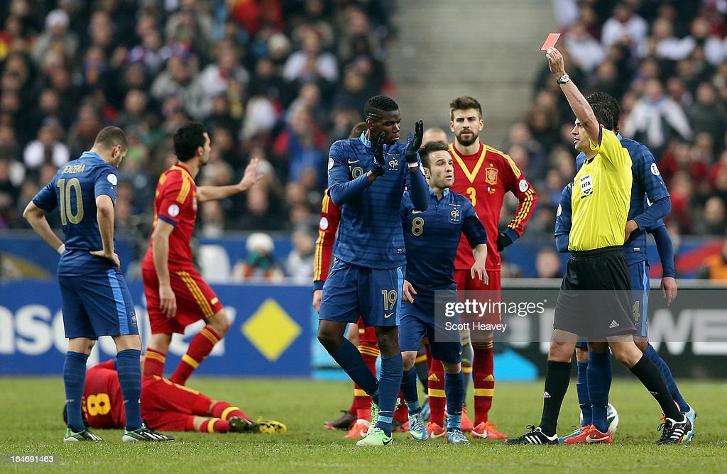 Paul Pogba (C) of France is shown the red card during a FIFA 2014 World Cup Qualifier between France and Spain at Stade de France on March 26, 2013 in Paris, France.