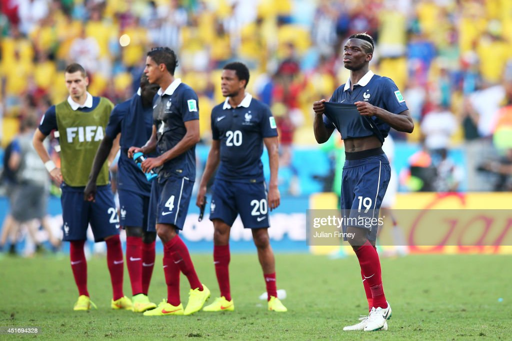 Paul Pogba of France (R) reacts after being defeated by Germany 1-0 during the 2014 FIFA World Cup Brazil Quarter Final match between France and Germany at Maracana on July 4, 2014 in Rio de Janeiro, Brazil.