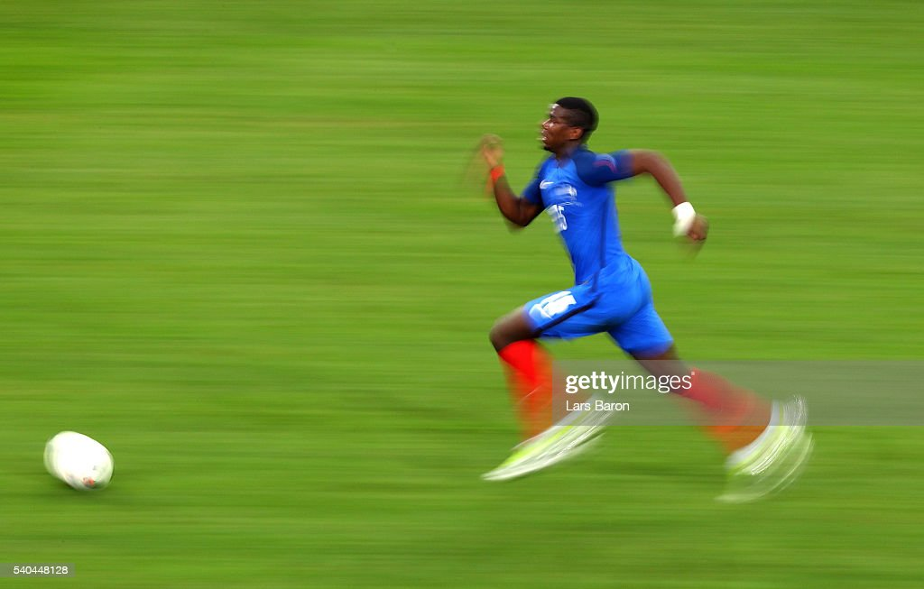 <a gi-track='captionPersonalityLinkClicked' href=/galleries/search?phrase=Paul+Pogba&family=editorial&specificpeople=5805302 ng-click='$event.stopPropagation()'>Paul Pogba</a> of France runs with the ball during the UEFA EURO 2016 Group A match between France and Albania at Stade Velodrome on June 15, 2016 in Marseille, France.
