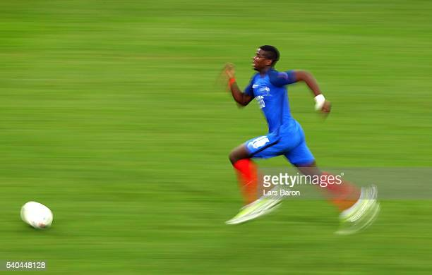 Paul Pogba of France runs with the ball during the UEFA EURO 2016 Group A match between France and Albania at Stade Velodrome on June 15 2016 in...