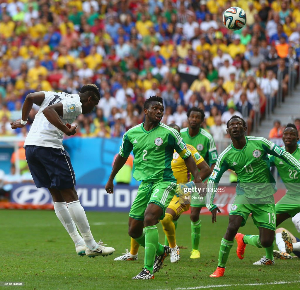 Paul Pogba of France scores his team's first goal on a header during the 2014 FIFA World Cup Brazil Round of 16 match between France and Nigeria at Estadio Nacional on June 30, 2014 in Brasilia, Brazil.