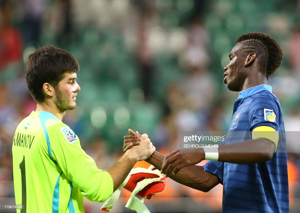 Paul Pogba (R) of France shakes hands with Asilbek Amanov of Uzbekistan after France's 4-0 victory over Uzbekistan during a quarter-final football match at the FIFA Under 20 World Cup at the Yeni Sehir stadium in Rize on July 6, 2013. France won 4-0.