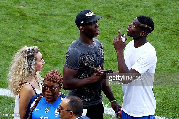 Paul Pogba of France talks to his family after the UEFA EURO 2016 round of 16 match between France and Republic of Ireland at Stade des Lumieres on...