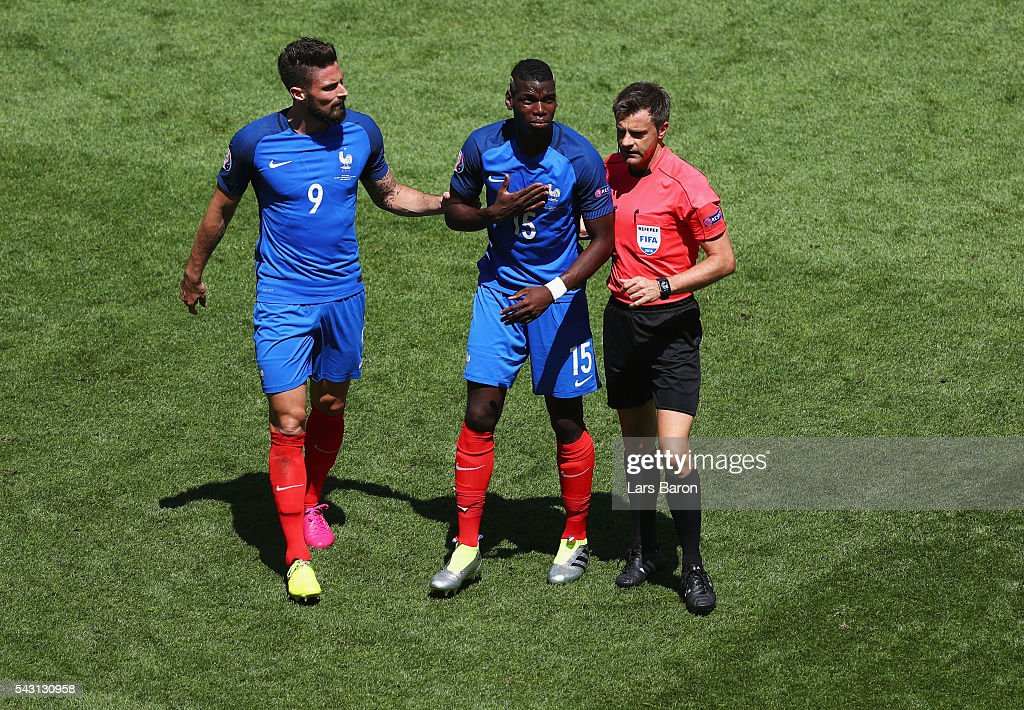 Paul Pogba (C) of France talks with referee <a gi-track='captionPersonalityLinkClicked' href=/galleries/search?phrase=Nicola+Rizzoli&family=editorial&specificpeople=4238940 ng-click='$event.stopPropagation()'>Nicola Rizzoli</a> (R) during the UEFA EURO 2016 round of 16 match between France and Republic of Ireland at Stade des Lumieres on June 26, 2016 in Lyon, France.
