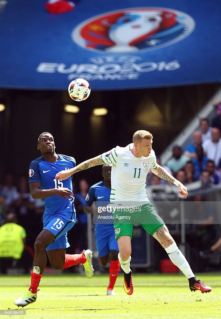 Paul Pogba of France (L) vies with James McClean of Ireland (R) during the UEFA Euro 2016 Round of 16 football match between France and Ireland at the Stade de Lyon in Lyon, France on June 26, 2016.