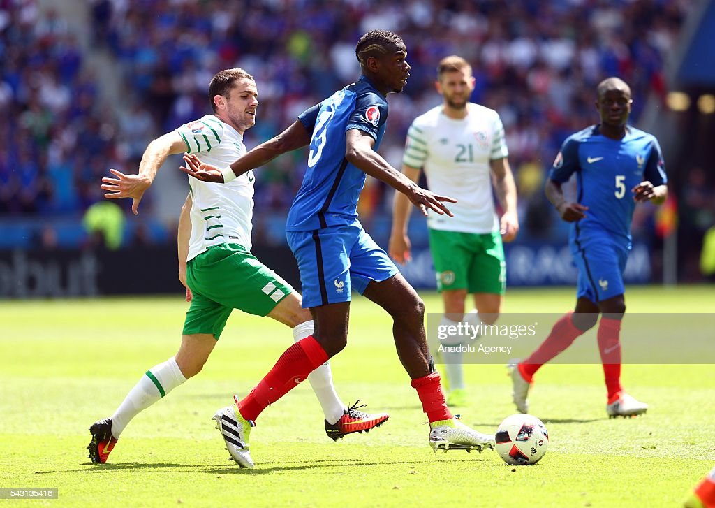 Paul Pogba of France (C) vies with Robbie Brady of Ireland (L) during the UEFA Euro 2016 Round of 16 football match between France and Ireland at the Stade de Lyon in Lyon, France on June 26, 2016.