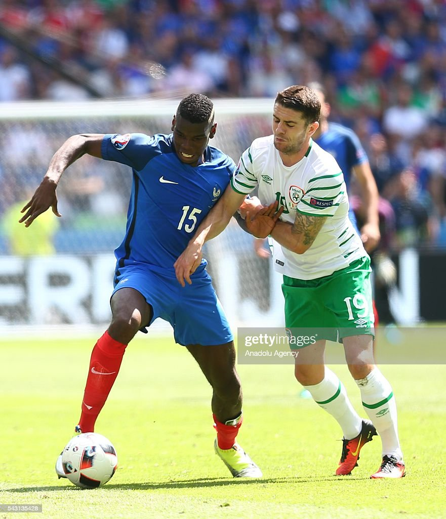 Paul Pogba of France (L) vies with Robbie Brady of Ireland during the UEFA Euro 2016 Round of 16 football match between France and Ireland at the Stade de Lyon in Lyon, France on June 26, 2016.