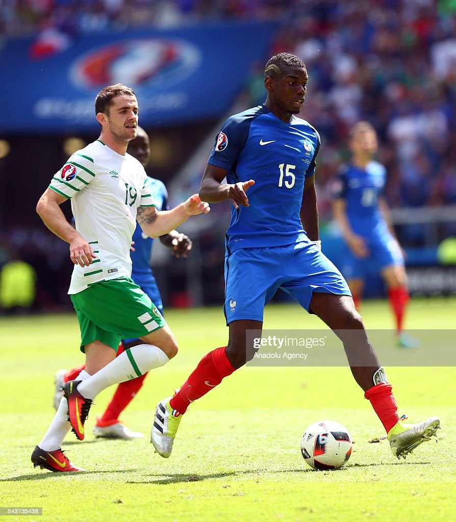 Paul Pogba of France (R) vies with Robbie Brady of Ireland (L) during the UEFA Euro 2016 Round of 16 football match between France and Ireland at the Stade de Lyon in Lyon, France on June 26, 2016.