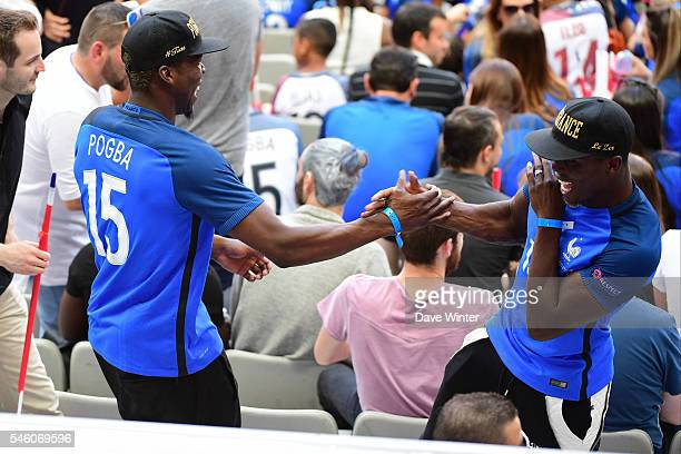 Paul Pogba of France's brothers during the European Championship Final between Portugal and France at Stade de France on July 10 2016 in Paris France