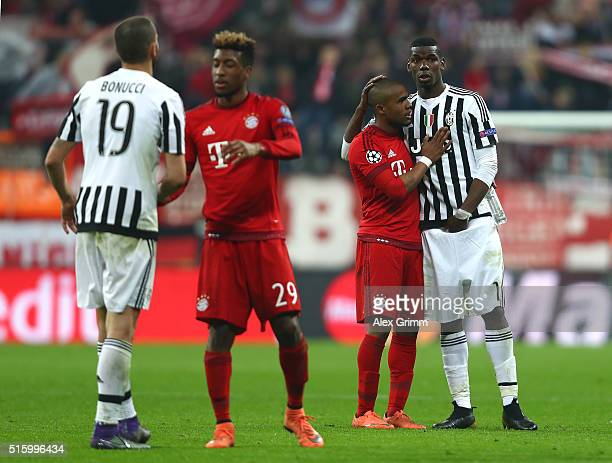 Paul Pogba of Juventus and Douglas Costa of Bayern Muenchen applaud after the UEFA Champions League round of 16 second Leg match between FC Bayern...