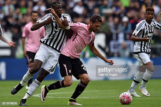 Paul Pogba of Juventus and Franco Vazquez of Palermo compete for the ball during the Serie A match between Juventus FC and US Citta di Palermo at...