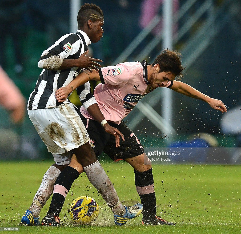 <a gi-track='captionPersonalityLinkClicked' href=/galleries/search?phrase=Paul+Pogba&family=editorial&specificpeople=5805302 ng-click='$event.stopPropagation()'>Paul Pogba</a> (L) of Juventus and Nicolas Viola of Palermo compete for the ball during the Serie A match between US Citta di Palermo v Juventus FC at Stadio Renzo Barbera on December 9, 2012 in Palermo, Italy.