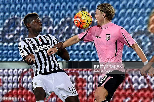 Paul Pogba of Juventus and Oscar Hiljemark of Palermo compete for the ball during the Serie A match between US Citta di Palermo and Juventus FC at...