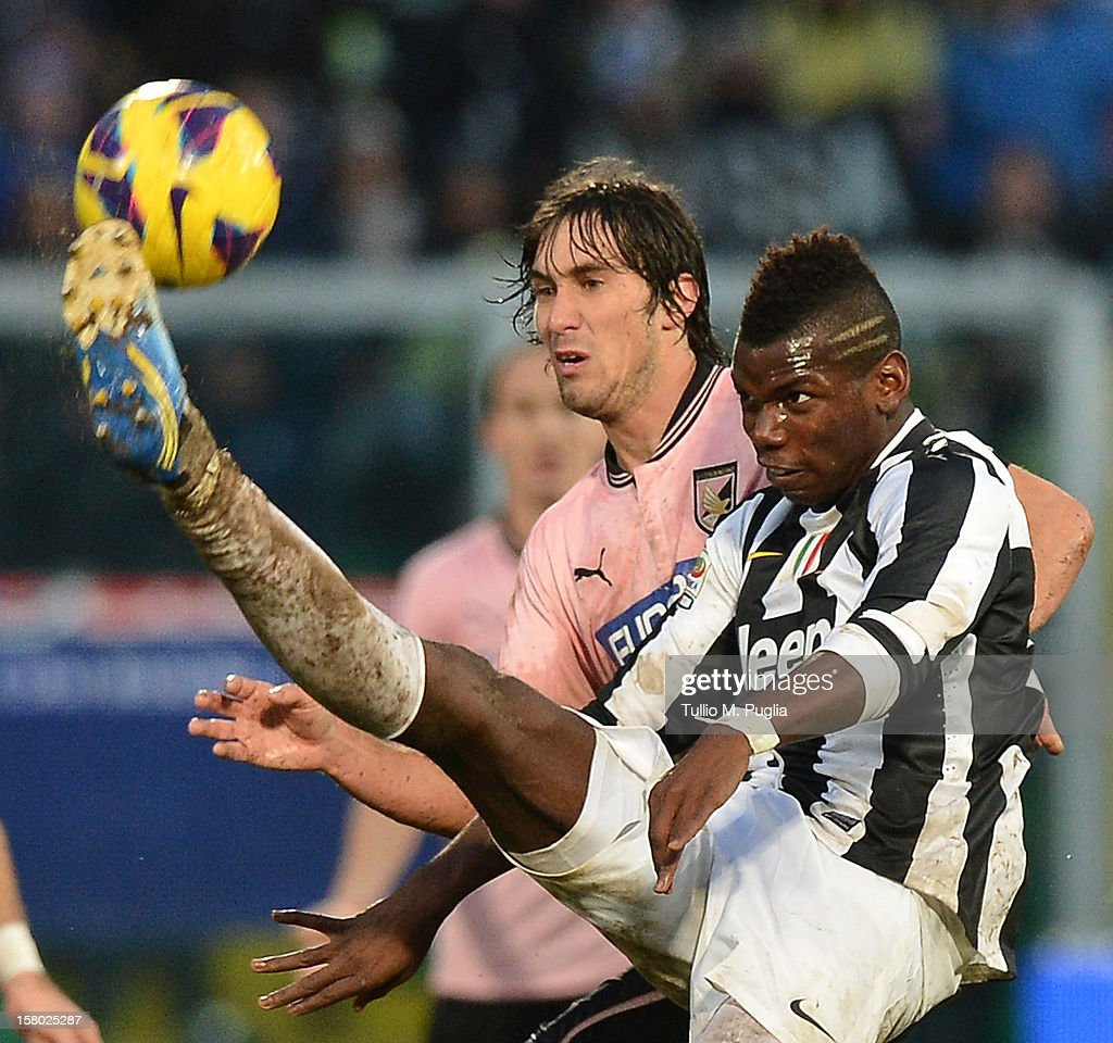 <a gi-track='captionPersonalityLinkClicked' href=/galleries/search?phrase=Paul+Pogba&family=editorial&specificpeople=5805302 ng-click='$event.stopPropagation()'>Paul Pogba</a> (R) of Juventus and Santiago Garcia of Palermo compete for the ball during the Serie A match between US Citta di Palermo v Juventus FC at Stadio Renzo Barbera on December 9, 2012 in Palermo, Italy.