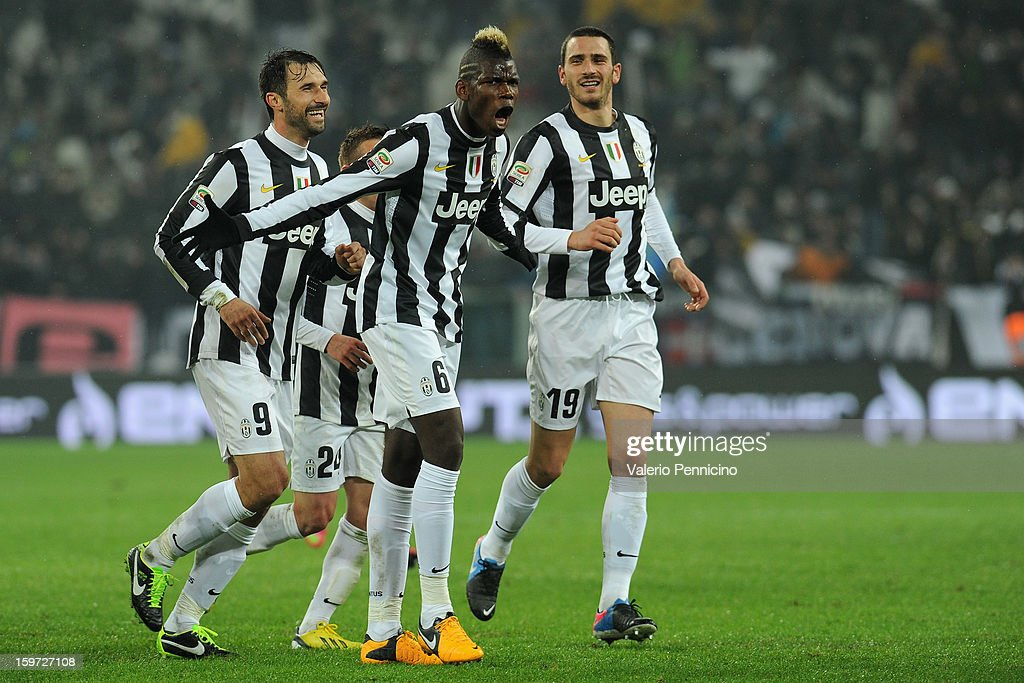 <a gi-track='captionPersonalityLinkClicked' href=/galleries/search?phrase=Paul+Pogba&family=editorial&specificpeople=5805302 ng-click='$event.stopPropagation()'>Paul Pogba</a> (C) of Juventus celebrates after scoring the opening goal during the Serie A match between Juventus and Udinese Calcio at Juventus Arena on January 19, 2013 in Turin, Italy.