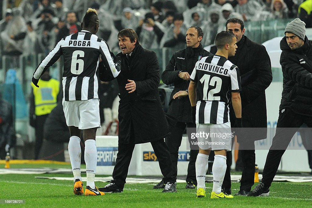 Paul Pogba (L) of Juventus celebrates after scoring the opening goal with head coach Antonio Conte during the Serie A match between Juventus and Udinese Calcio at Juventus Arena on January 19, 2013 in Turin, Italy.