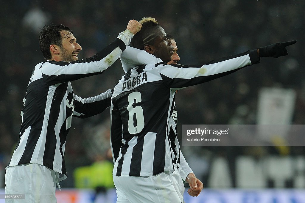 Paul Pogba (R) of Juventus celebrates after scoring the opening goal with team-mates Mirko Vucinic during the Serie A match between Juventus and Udinese Calcio at Juventus Arena on January 19, 2013 in Turin, Italy.