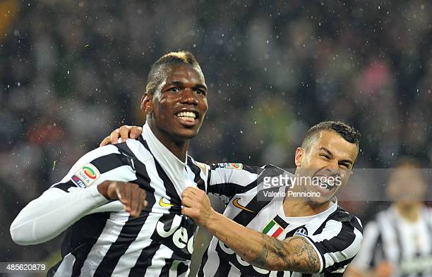 Paul Pogba of Juventus celebrates after scoring the opening goal with team mate Sebastian Giovinco during the Serie A match between Juventus and...