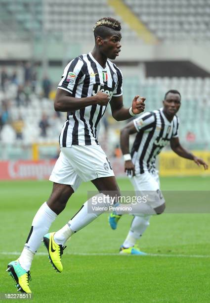 Paul Pogba of Juventus celebrates the opening goal during the Serie A match between Torino FC and Juventus at Stadio Olimpico di Torino on September...