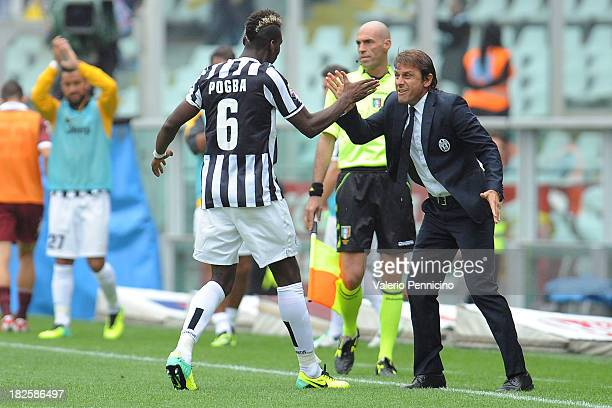 Paul Pogba of Juventus celebrates the opening goal with his head coach Antonio Conte during the Serie A match between Torino FC and Juventus at...