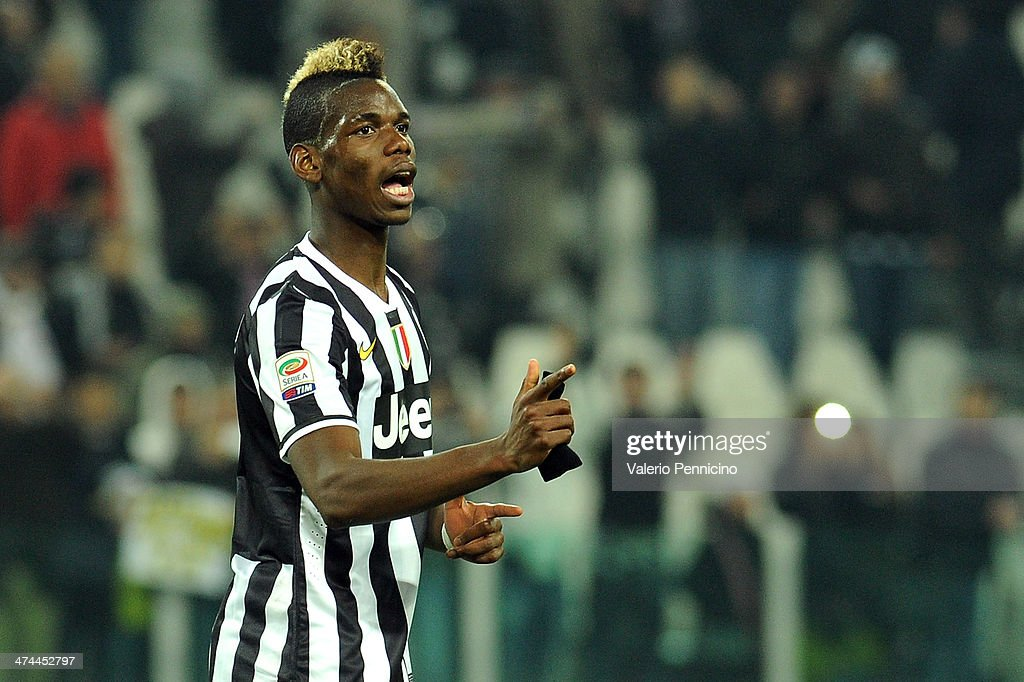 <a gi-track='captionPersonalityLinkClicked' href=/galleries/search?phrase=Paul+Pogba&family=editorial&specificpeople=5805302 ng-click='$event.stopPropagation()'>Paul Pogba</a> of Juventus celebrates victory at the end of the Serie A match between Juventus and Torino FC at Juventus Arena on February 23, 2014 in Turin, Italy.