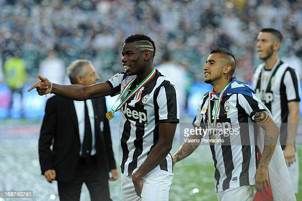 Paul Pogba of Juventus celebrates win the Serie A Championships at the end of the Serie A match between Juventus and Cagliari Calcio at Juventus...