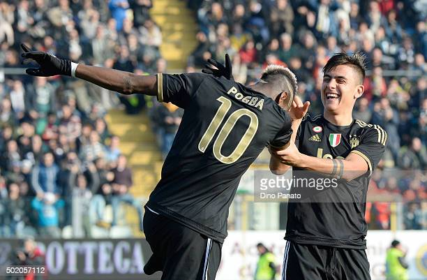 Paul Pogba of Juventus celebrates with his team's mate Paulo Dybala after scoring his team's third goal during the Serie A match between Carpi FC and...