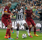 Paul Pogba of Juventus competes for the ball with Maicon and Radja Nainggollan during the Serie A match between Juventus FC and AS Roma at Juventus...